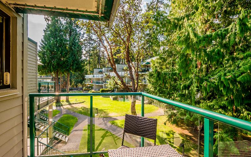 Enjoy the balcony off the kitchen and garden views after a game of tennis