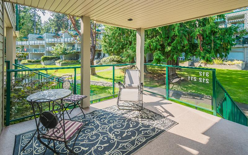 Quaint entrance and large back covered patio overlooking the gardens and trees