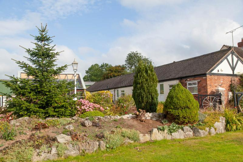 The Corn Store, Birchenfields - 4 person cottage with use of large play barn, vacation rental in Cheadle