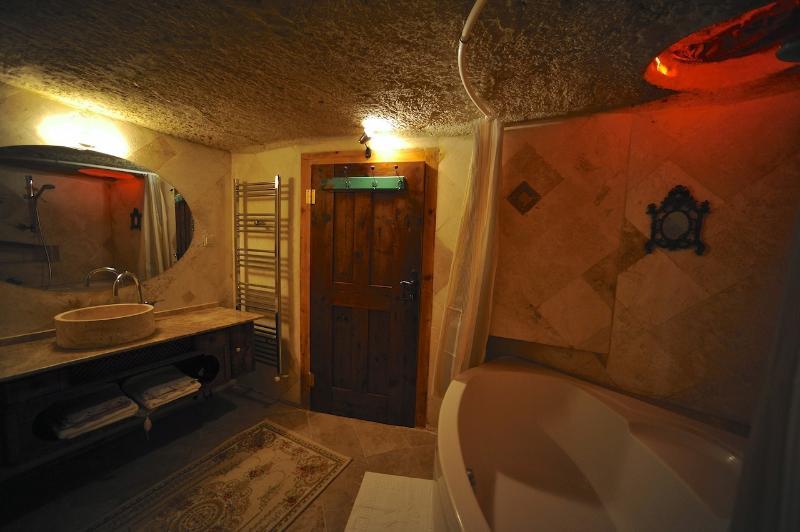 Cave bathroom with bathtub