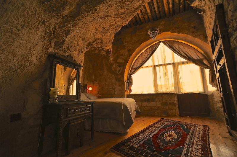 Cave bedroom with a nice view of Cappadocian landscape, Erciyes mountain and the sunrise