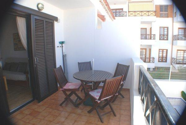 Spacious Balcony with table and seating for 4 for alfresco dining.