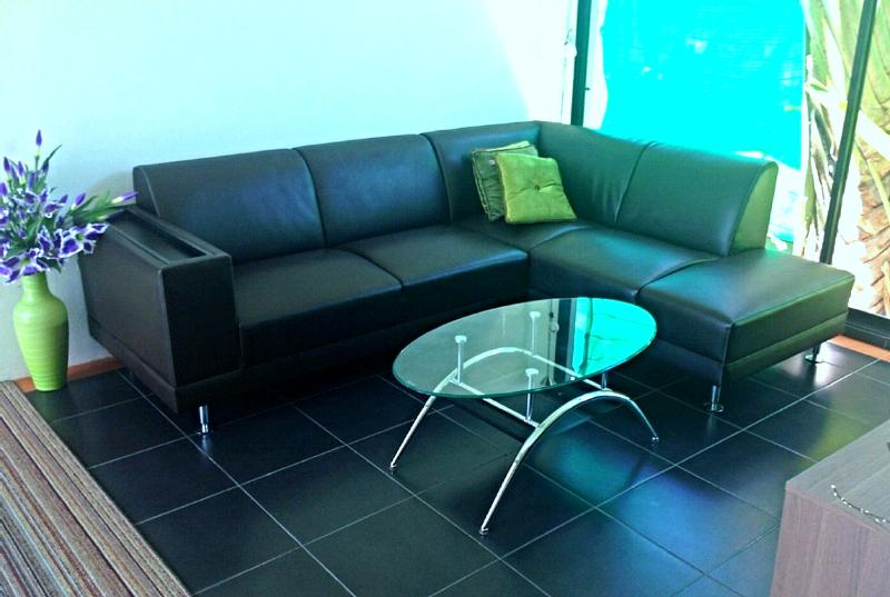 Sofa in thew TV-Room, with flatscreen TV and DVD