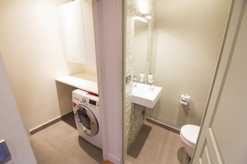 Separated toilet and laundry room