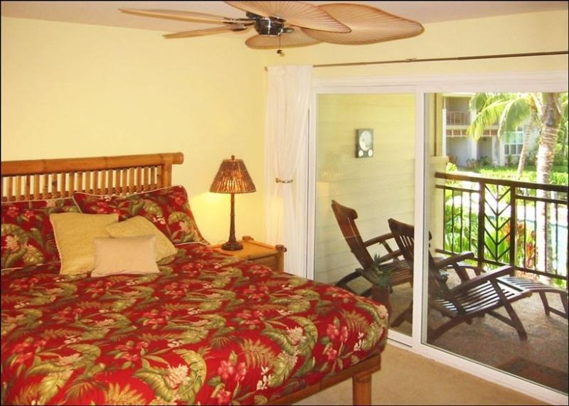 Master bedroom with lanais overlooking the pool