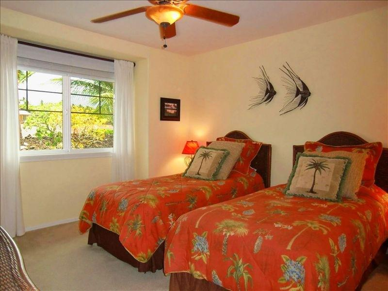 Second bedroom can be made up with two twin beds or one king bed