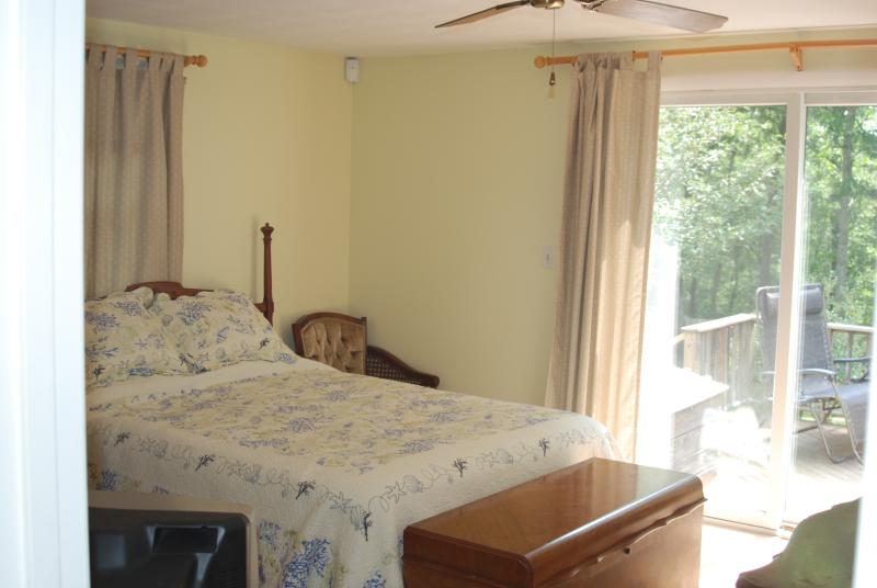 Lovely master bedroom, queen bed, master bath,  slider to main deck, TV, AC and ceiling fan