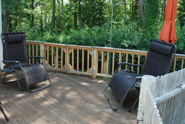 Shady driveway side deck #2 also with anti gravity loungers and deck furniture