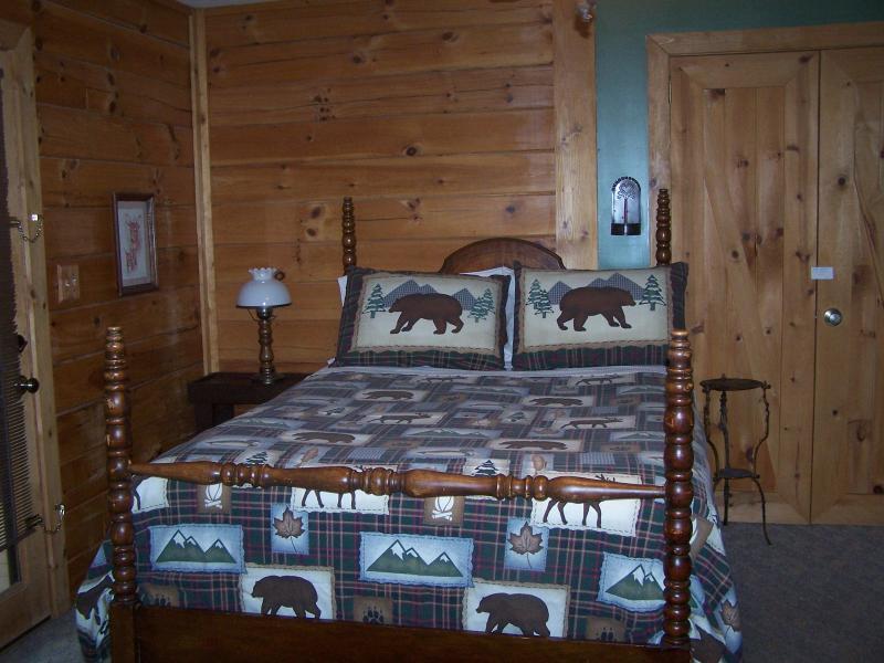 Queen bed in master bedroom with bathroom