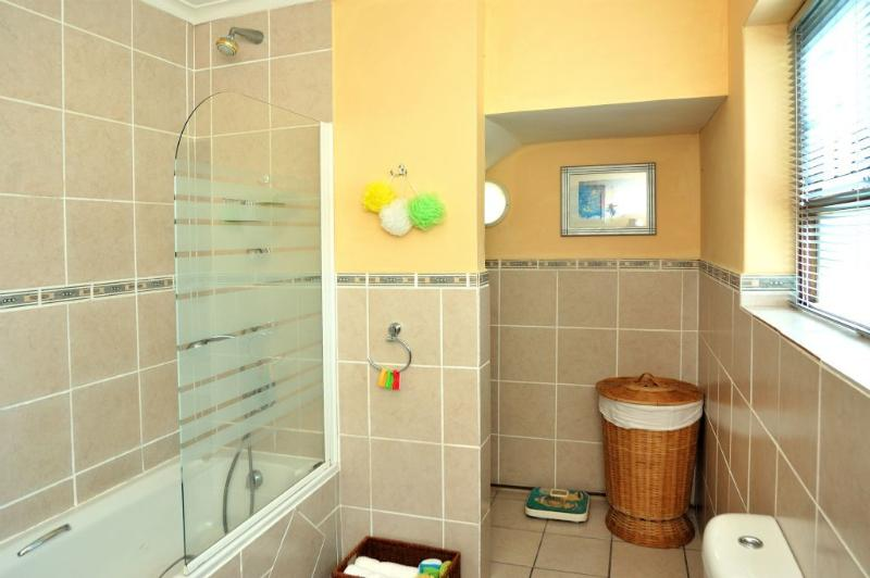 Another view of the bathroom which is situated between the two bedrooms