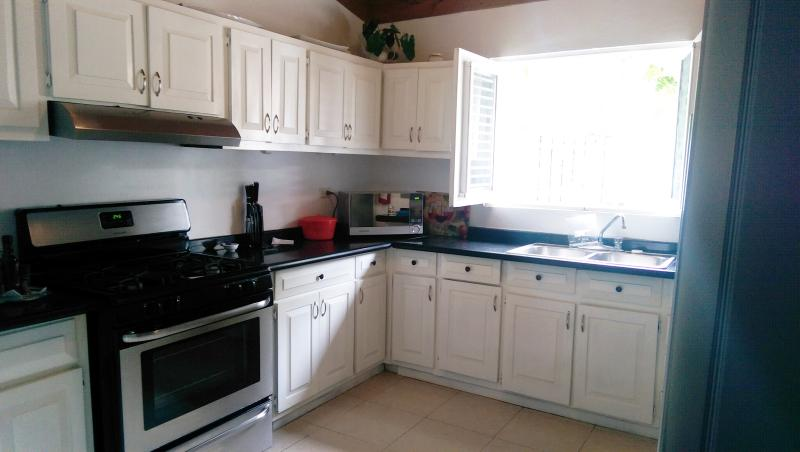 New stainless stove, refrigerator and microwave