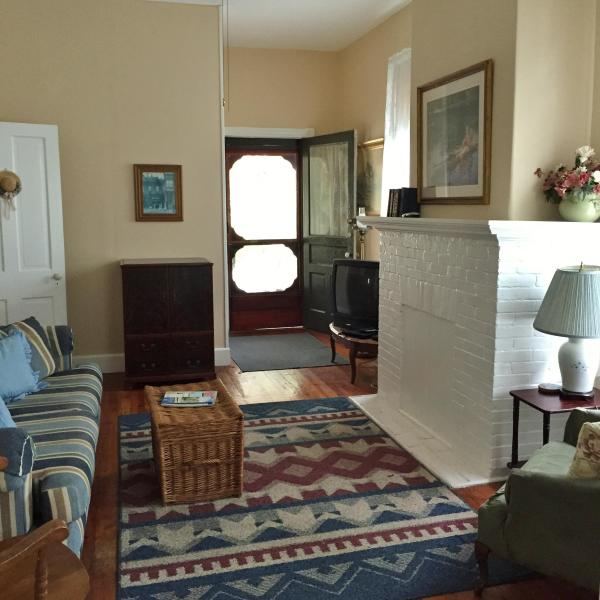 family room has front door that walks out to the front porch