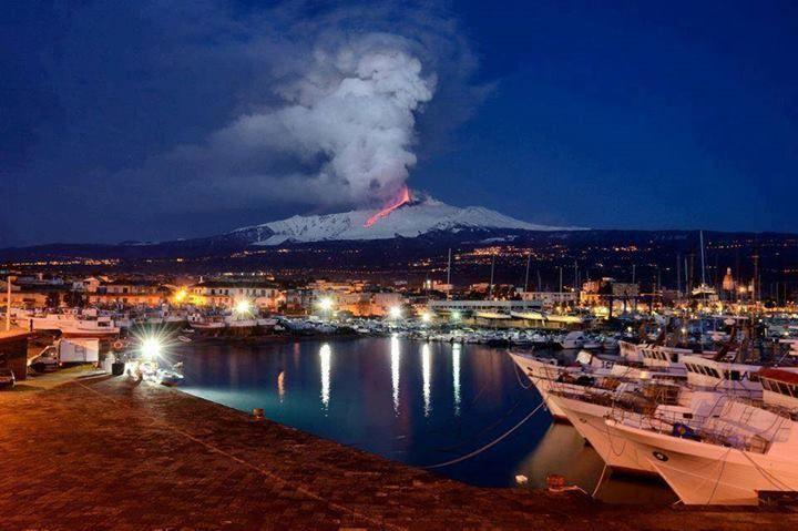 Etna erupting view from marina Riposto