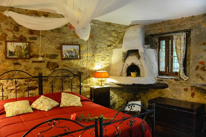 Ruby Room with antique oven and overlooks the terrace