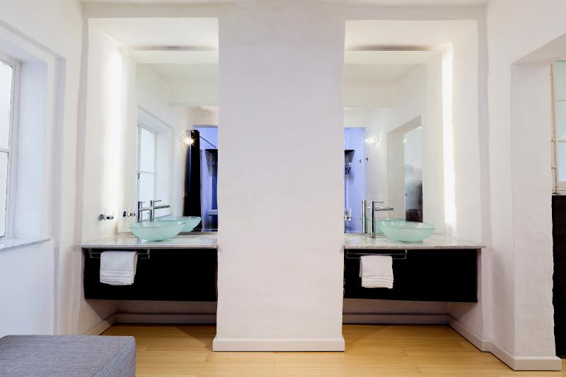 His&Her dressing tables with full-height mirrors behind.