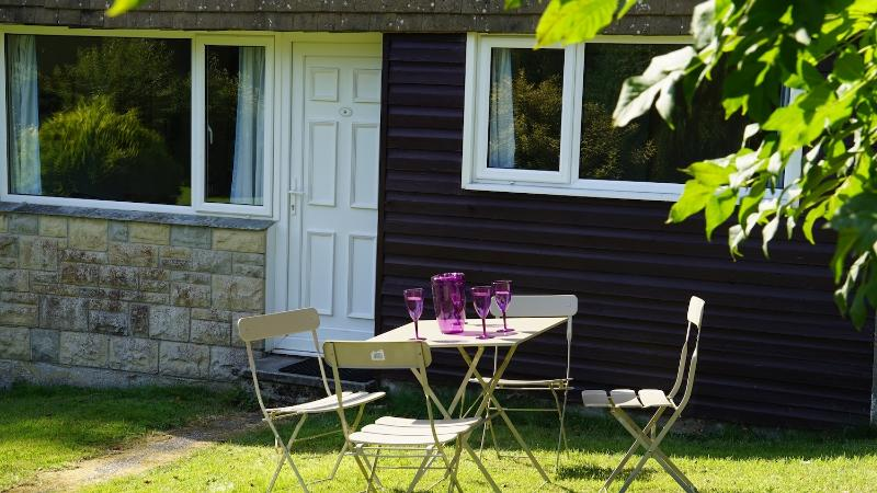 Patio table and chairs outside your sunny, south facing holiday home.