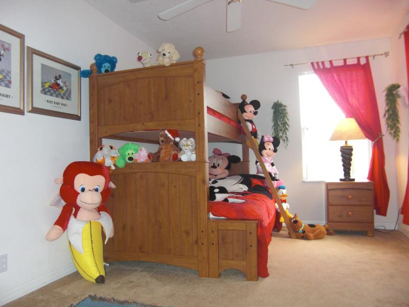 Mickey Mouse Themed Bedroom with double bottom bunk, single top bunk