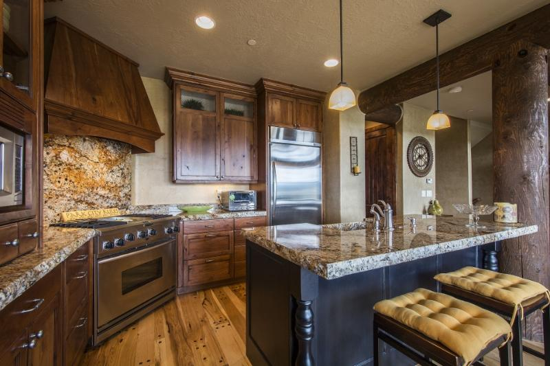 Gourmet Kitchen Stainless, Farm Sink Island, and Knotty Alder Cabinets