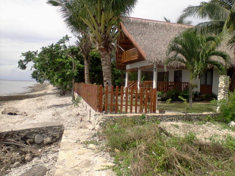Beach side of our house,own sand/corals beach, house reef with plenty of colered fish.