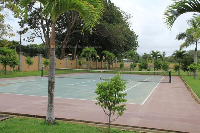 Community tennis court. Racquets and balls are available for rent in the EcoVida Office
