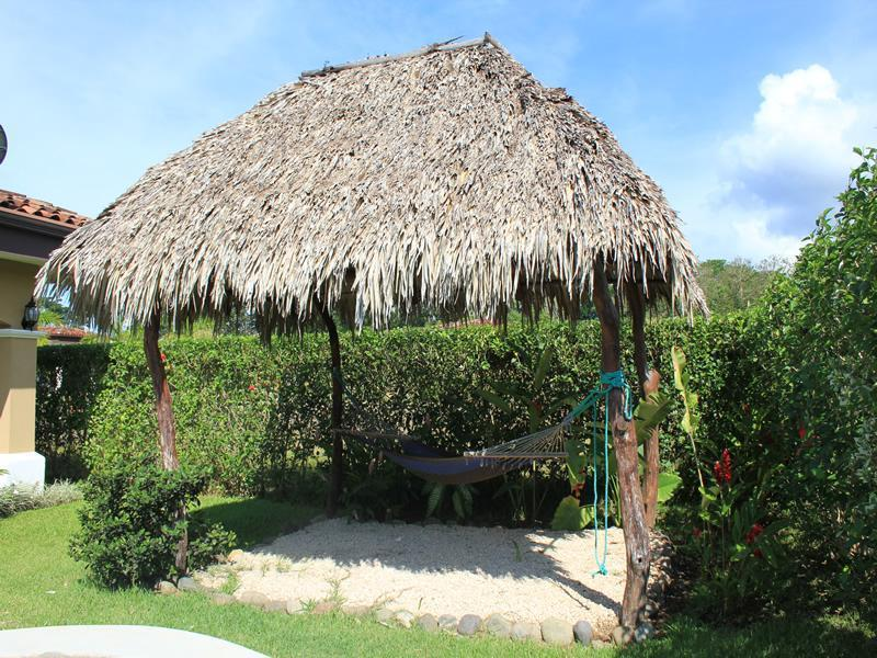 After a dip in the pool take a nap in the hammock in the rancho!