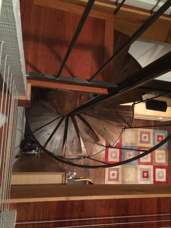 Looking down spiral staircase to living area