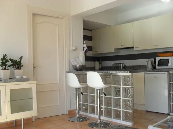 Open kitchen with bar and seats