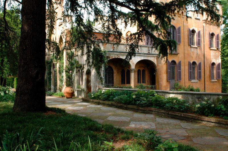 Neo-gothic castle seen from the garden of Villa Silvio Pellico