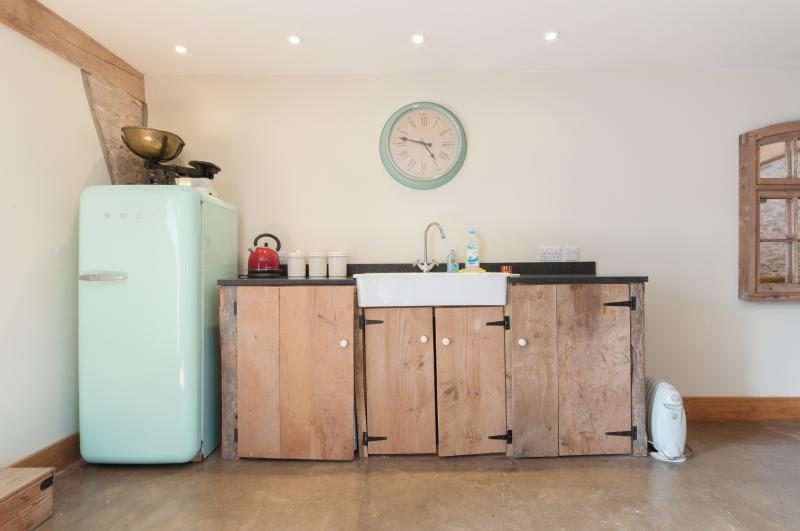 There is also a utility area with washing machine and freezer for guests to use