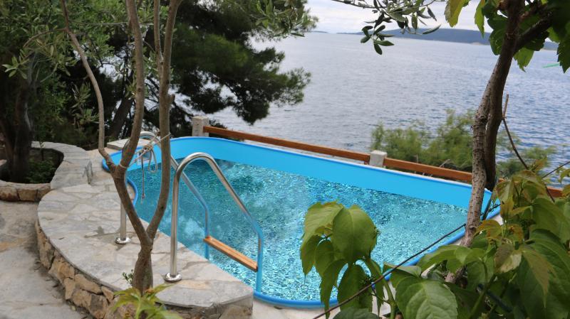 Summerhouse-apartman juric-Trogir-okrug donji, holiday rental in Ciovo Island