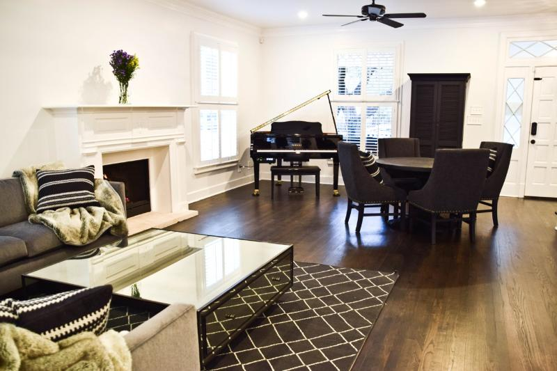 The Foyer: Dining room table, Yamaha Baby Grand Player Piano and fireplace.