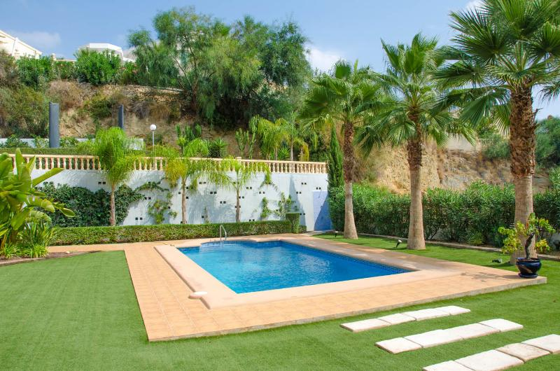 Enjoy the wonderful garden and private pool.