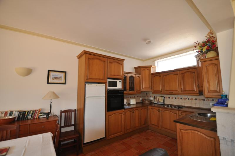 Well equipped kitchenette with hob, oven, microwave, fridge freezer, full cutlery and crockery sets.