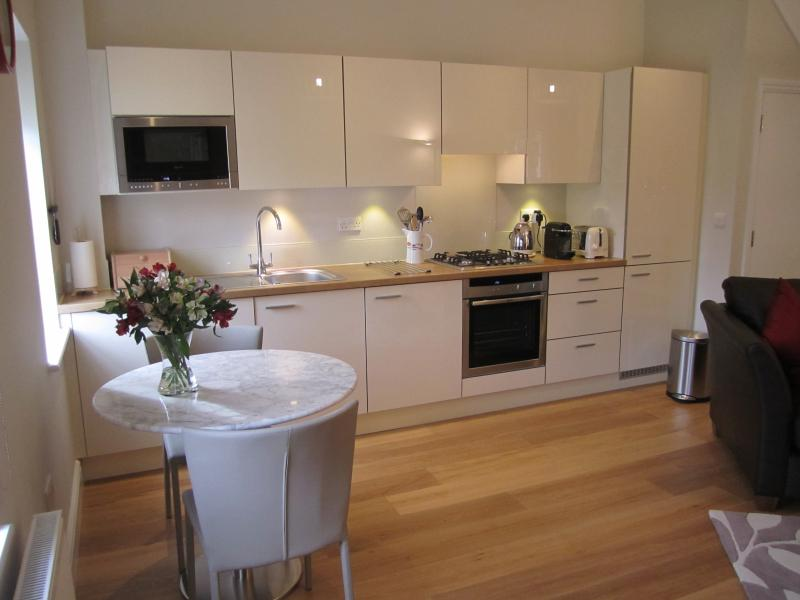 Fully fitted kitchen with marble dining/ work table.
