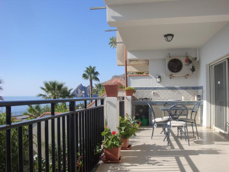 Spacious sea-facing terrace with grill, dining and sitting areas, views of Medieval castle and Italy
