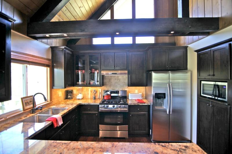 Large open kitchen with new stainless steel appliances