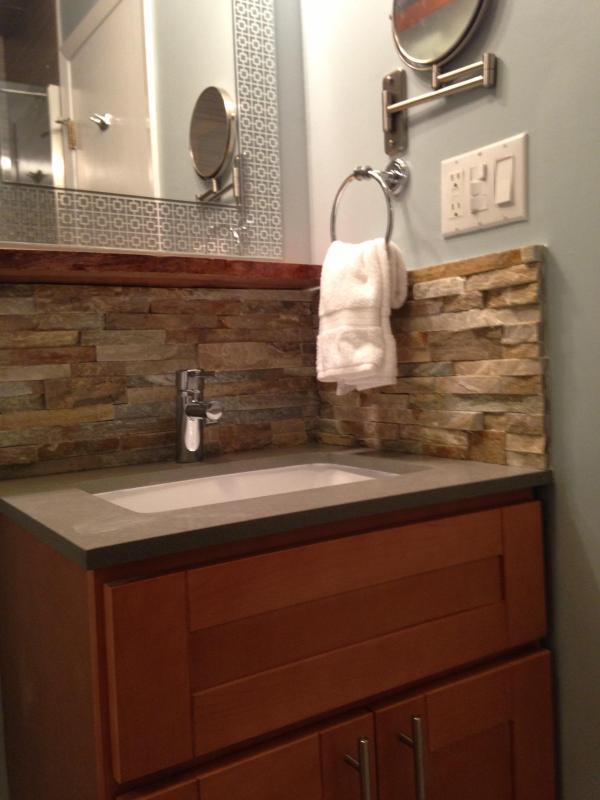 1st floor bath with ledge stone backsplash, buddha stone counter and hans grohe faucet
