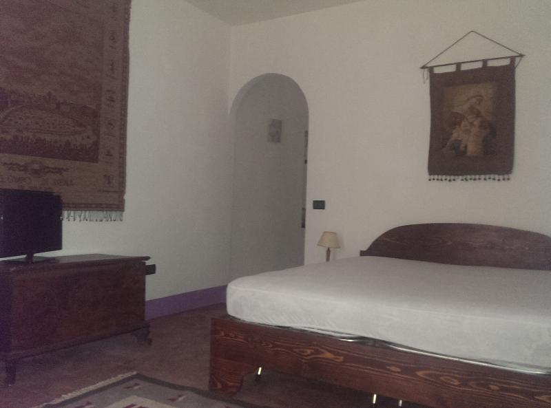 double bedroom with antique chest