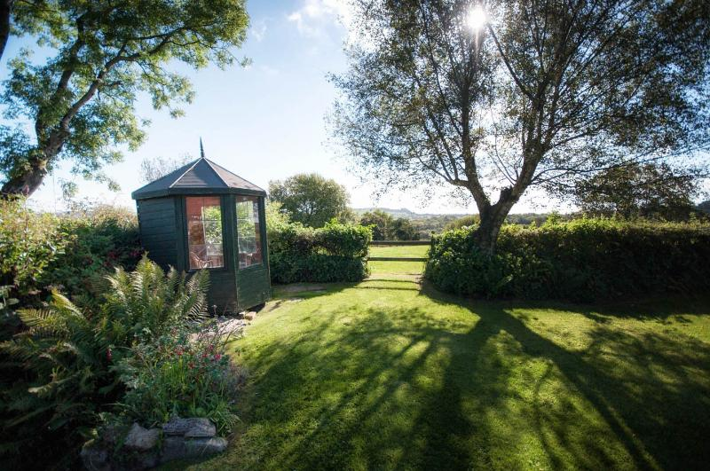 Sunny private garden with summer house and views over beautiful Dorset countryside