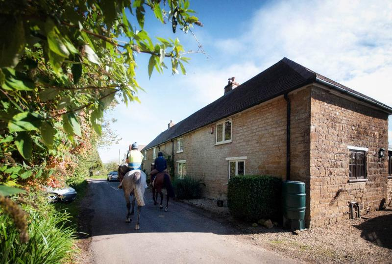 Front of cottage on quiet country lane