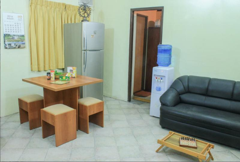 View of Dining Area, with Refrigerator and Hot & Cold Water Dispenser