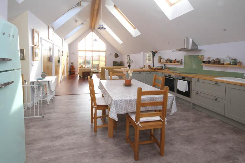 Beautifully light and spacious kitchen/diner. Six electric Velux windows with blinds.