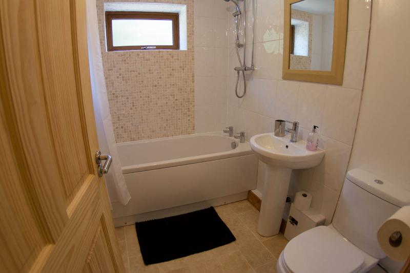 Power Shower over bath; sink and toilet in ground floor bathroom