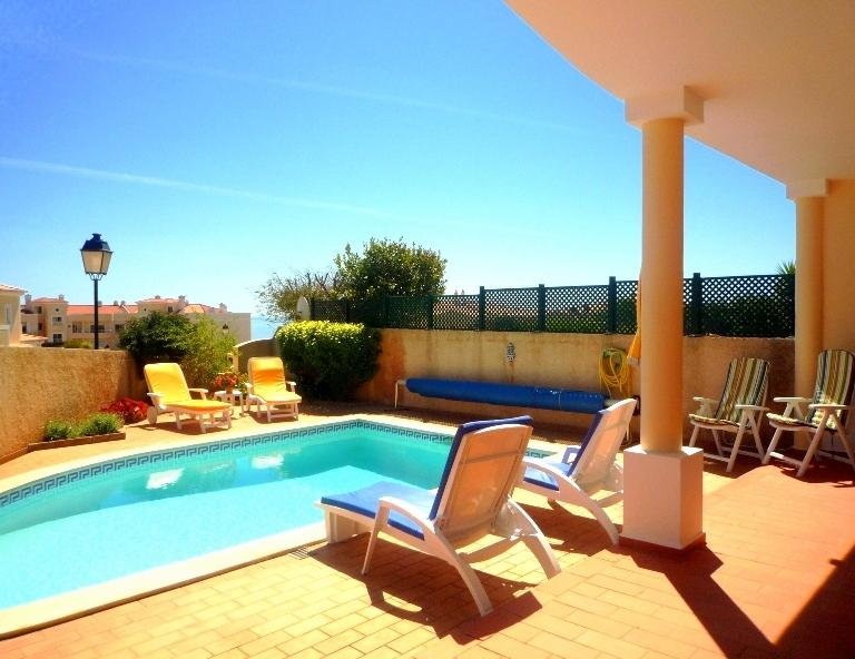 Sheltered pool area with nice patio furniture to relax and unwind