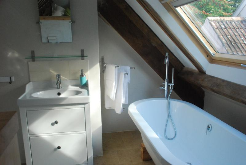 Brand new ensuite bathroom in the loft from with a free standing bath to relax in..