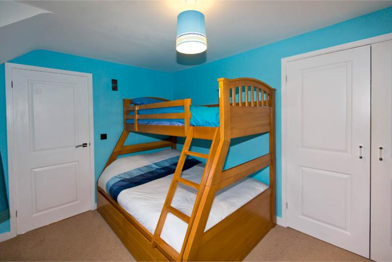 Triple bunk room with full size double and single