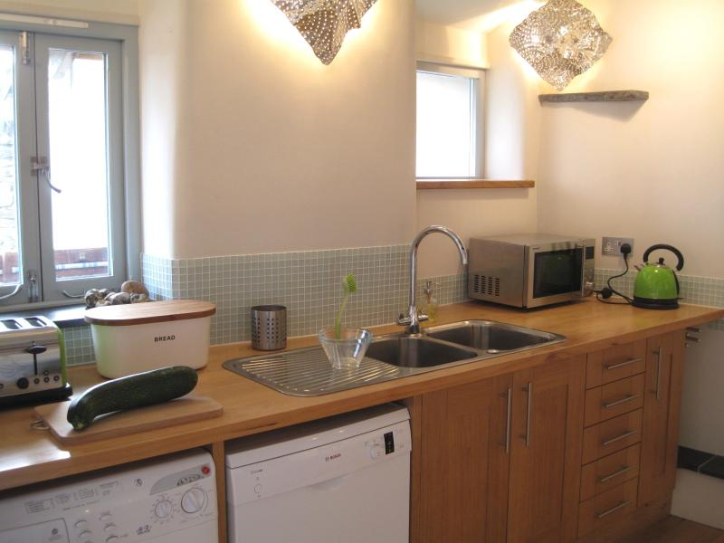 The kitchen - check out the hand made lights in the corner.. excellent for rustling up dinner too