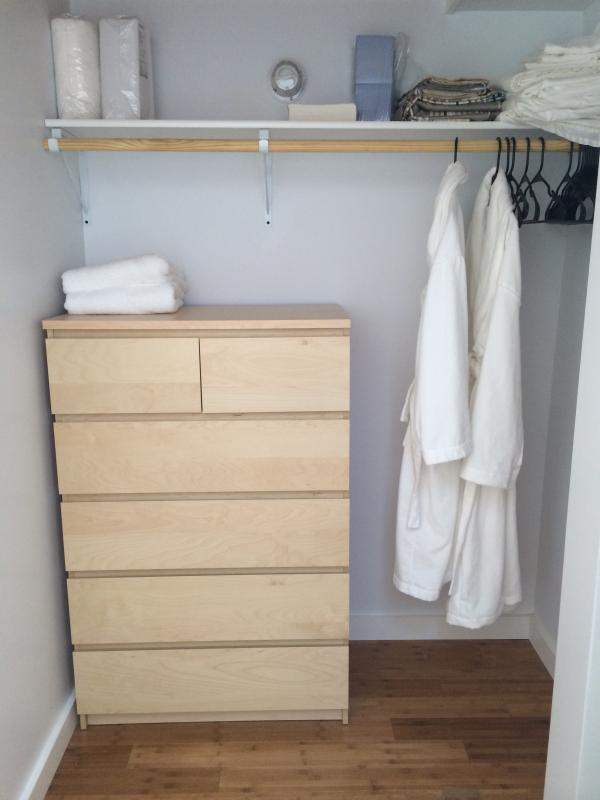 Closet with storage, and robes.  This is the spot to look for more towels or linens.