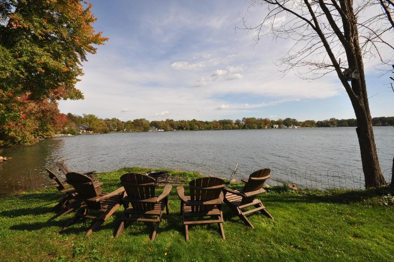 Fire pit and lounge chairs next to the lake