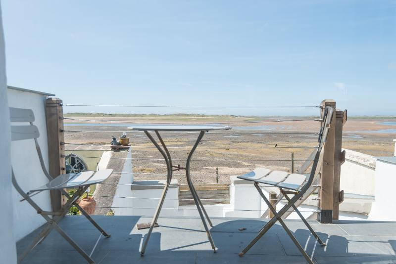 The patio overlooks the beach and the fells in the wider panoramic view